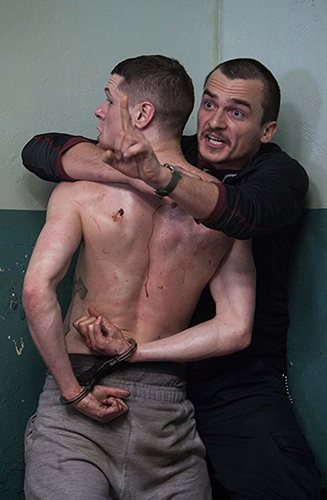 Rupert Friend and Jack O'Connell in Starred Up - Copyright 2014 - Tribeca Film - Credit IMDB