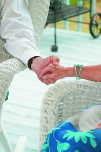 seniors holding hands social care cuts