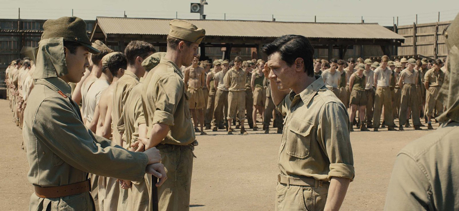 Garrett Hedlund, Jack O'Connell, and Miyavi in Unbroken - Copyright 2014 - Universal Pictures - Credit IMDB