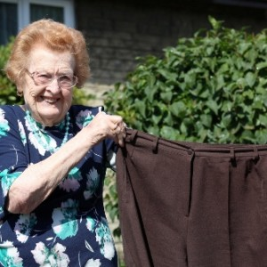 Betty Jones, 92, with a pair of her old wide-waisted trousers