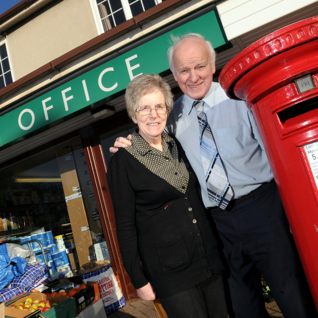 Joyce and Don Olivant outside Cherry Tree Hill Post Office, Derby.  See Newsteam story NTIPOST; A couple believed to be Britain's longest serving postmasters have finally retired - after almost 60 YEARS. Don and Joyce Olivant, both 71, have decided to bid farewell to their local post office which has been run by their family since 1947. Yesterday (Tue) the couple weighed their final parcels and arranged their last deliveries at Cherry Tree Hill Post Office, in Chaddesden, Derby. They have both provided a first-class service behind the counter of the store since 1978 but Don has been working there since he was 14-years-old. His father Alfred set up the business in 1947 and he became the country's youngest postmaster in 1968 when he took it over at the age of 23.