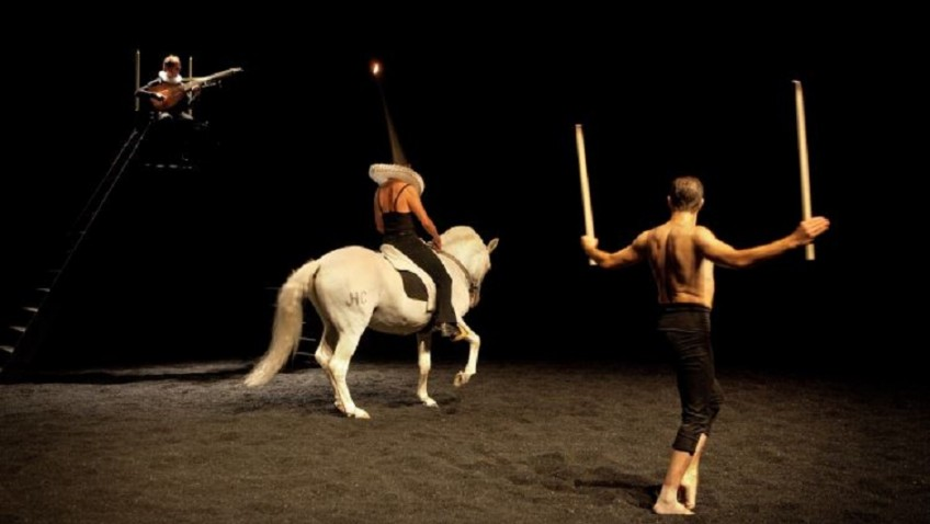 A religious ritual with horses on stage