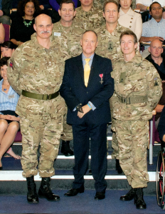 Ray Edwards quad amputee with armed forces personnel