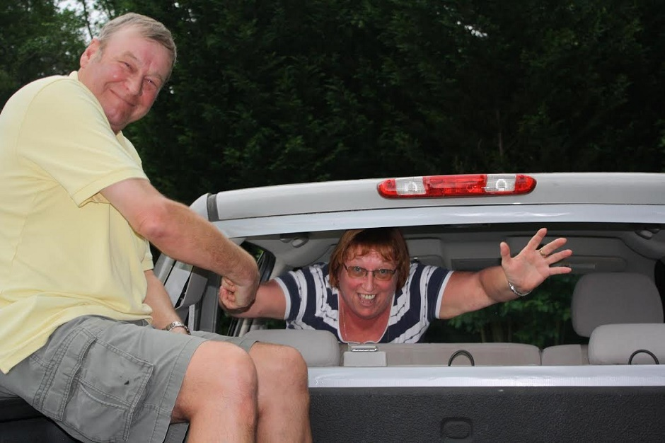 man and woman in back of car