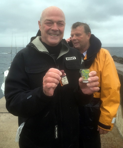 Chris Loughridge at the end of his journey across the North Channel from Cushendall in Northern Ireland to the Mull of Kintyre. A thrill-seeking granddad Chris Loughridge has become a world record-breaker after WINDSURFING from Northern Ireland to Scotland in just 100 minutes - quicker than a ferry. See Centre Press story CPSURF; Chris Loughridge, 57, made the 16-mile journey  in record time on Sunday - celebrating his arrival on the Scottish coast with a dram of whisky. And Chris made the trip across the North Channel from the village of Cushendall in County Antrim to the Mull of Kintyre lighthouse quicker than a ferry.Chris, a dentist, said he was surprised he completed the journey because the wind and rain were so bad he even couldn't see the Scottish coast until he was only 400m away.