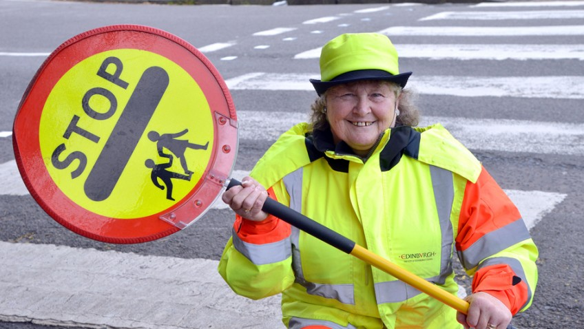 "Lollipop lady retires from ""temporary job"" after 40 years"