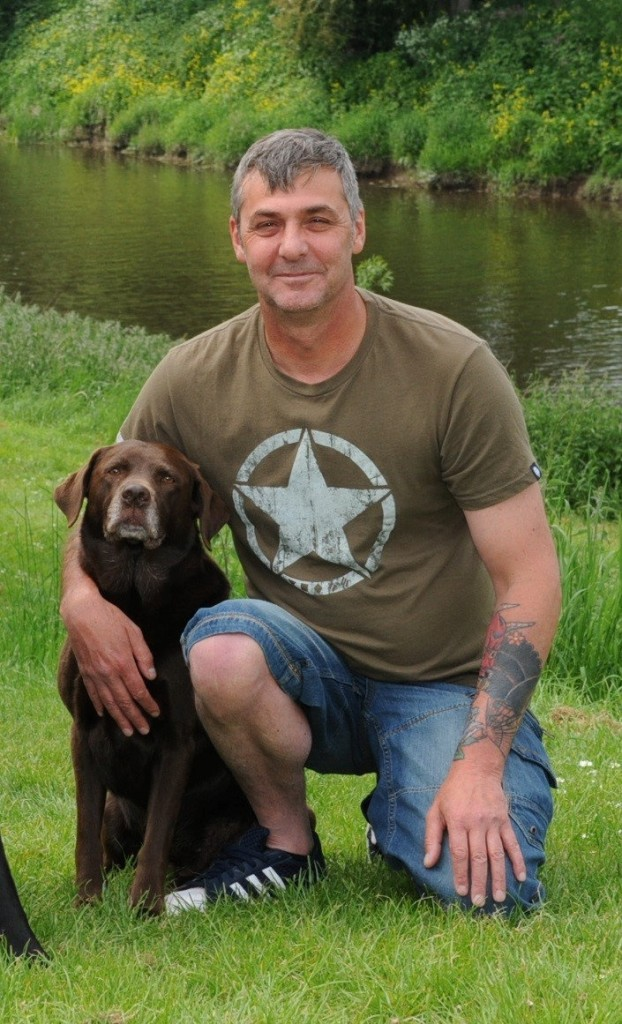 Martin Green with Wispa the dog which helped Pete Alderson - Copyright SWNS.com - Credit SWNS.com