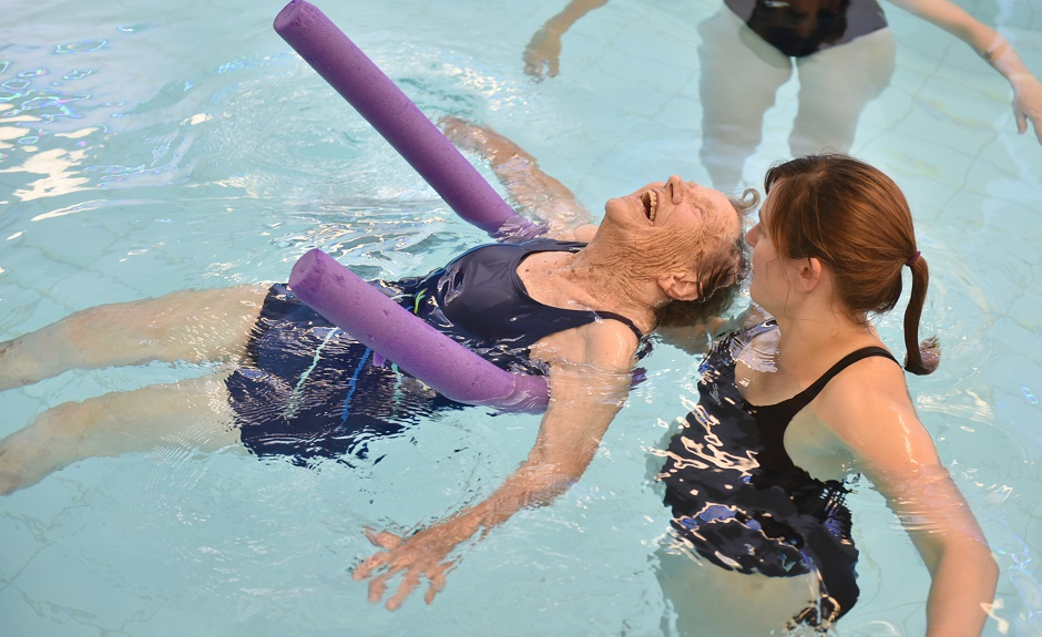 Pic of 100 year old Sadie Knight from Oakhaven Residential Home who has had her wish come true to go swimming again! Pic of Sadie swimming  at the national Star College  See SWNS story SWSWIM;  A 100-year-old dementia sufferer brims with water delight as she goes for a swim - for the first time in 35 YEARS. Great-grandmother Sadie Knight grins in delight as she splashes around in the water - forgetting the fact that she struggles to walk. The retired print worker thought she would never go for a dip again after giving up swimming in the 1980s as old age began to take its toll. She loved the water as a little girl when her mother would take her to the beach on rare holidays between the First and Second World Wars. Later in life she joined swimming clubs and went for daily dips in the sea with husband Alf, a former Royal Navy officer.