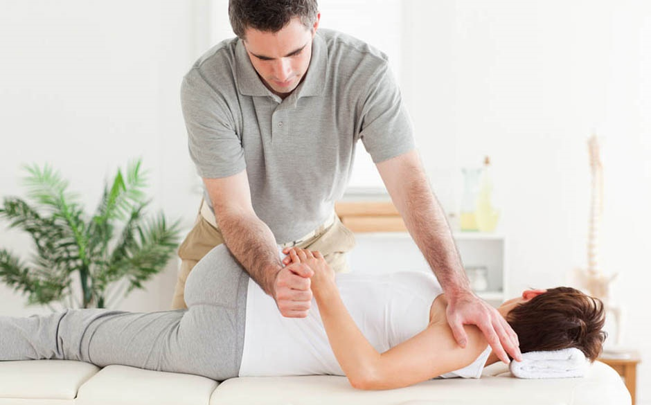 physiotherapist bending arm and shoulder