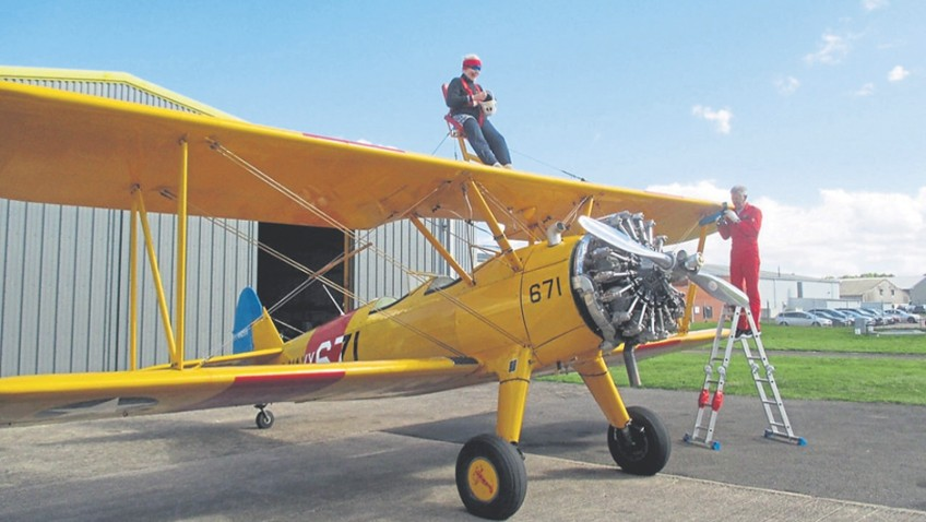 A daring 87-year-old has become Britain's oldest female wing-walker
