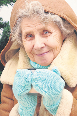 Cold old woman with hot drink