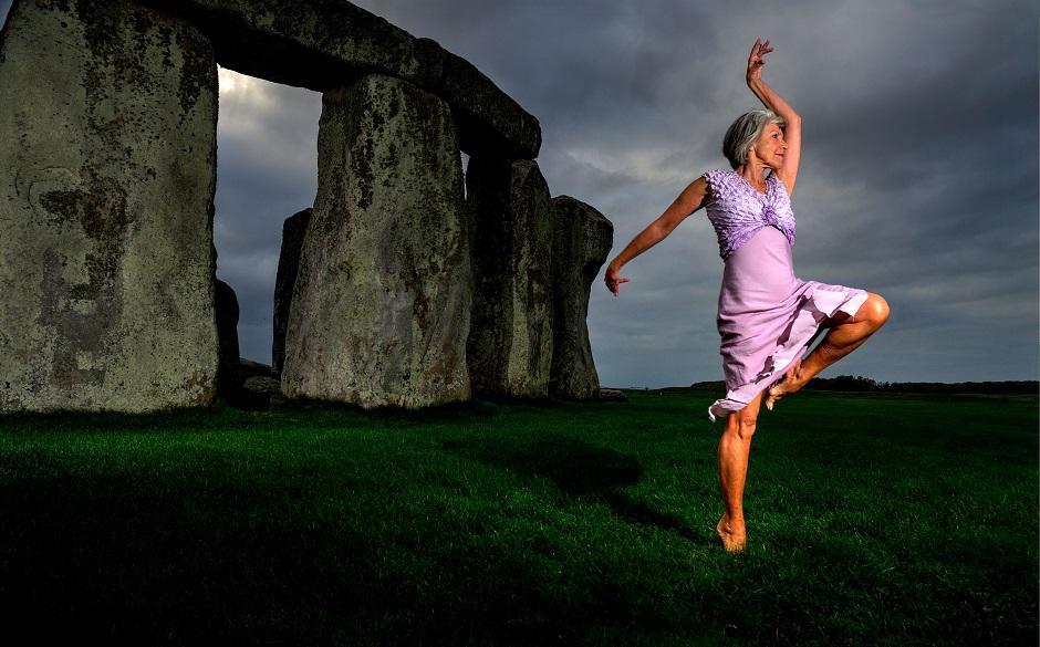 older woman dancing in Stonehenge