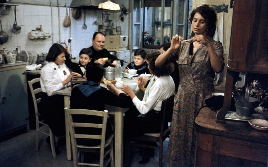 Italian family eating round table in kitchen
