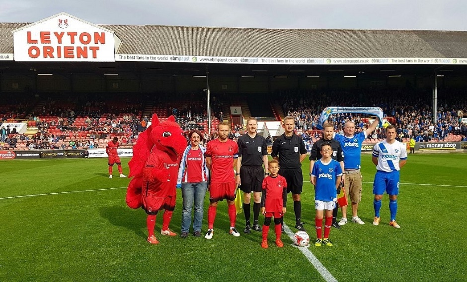 football team before kick off with mascots
