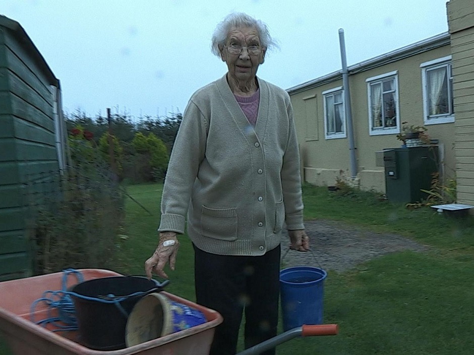 elderly lady with buckets