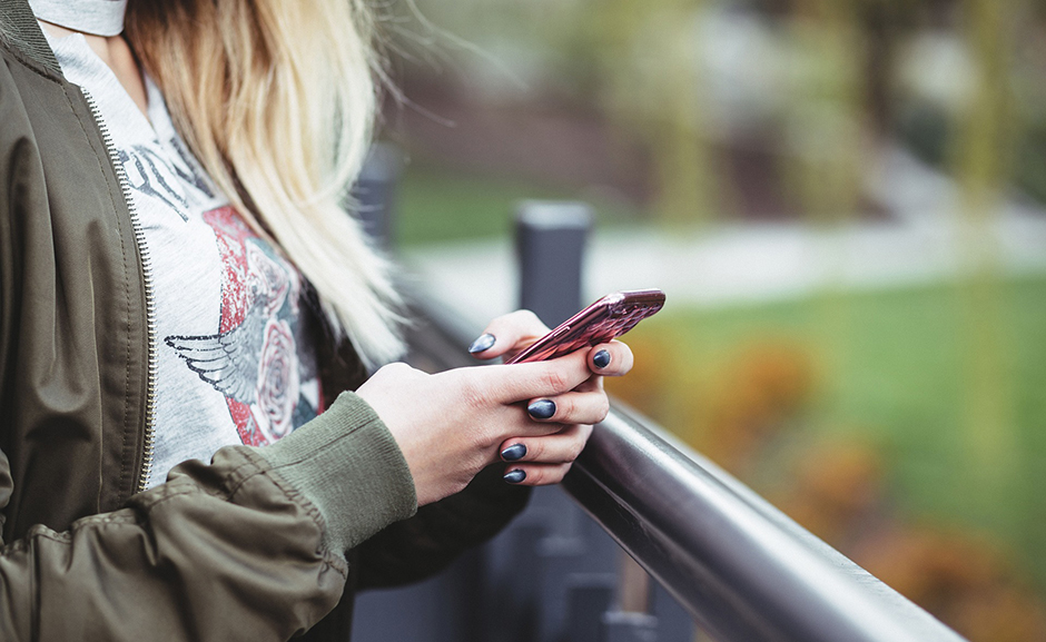 Girl using mobile phone - Free for commercial use No attribution required - Credit Pixabay