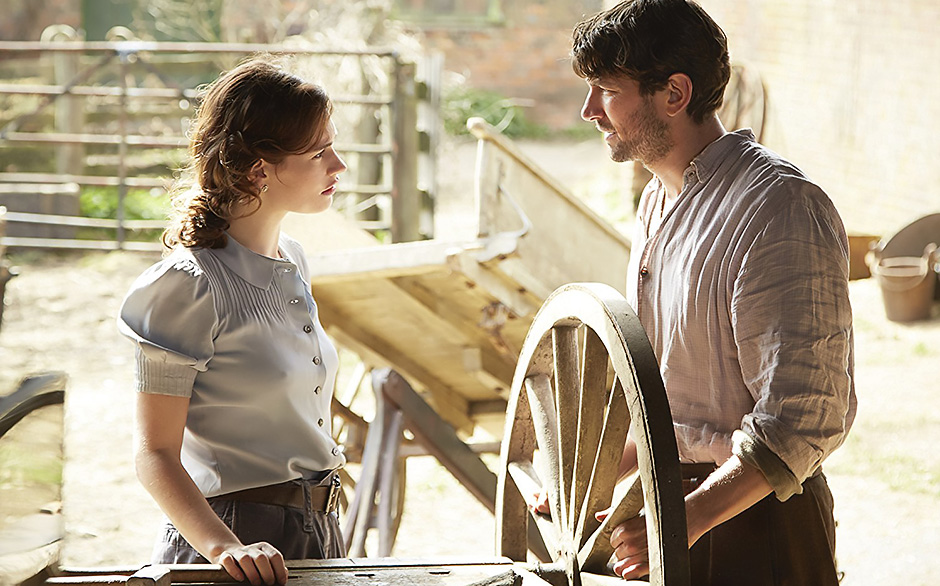 Michiel Huisman and Lily James in The Guernsey Literary and Potato Peel Pie Society - Credit IMDB