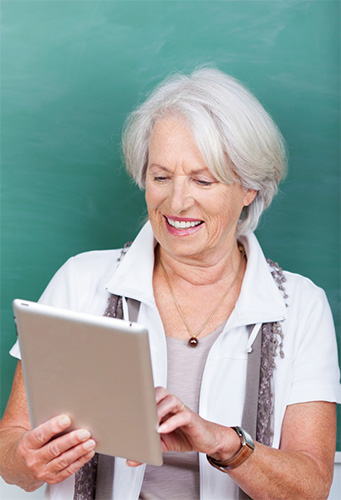 Older woman using tablet