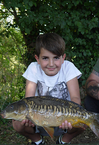 Angling Trades Association - National Fishing Month - Boy with fish