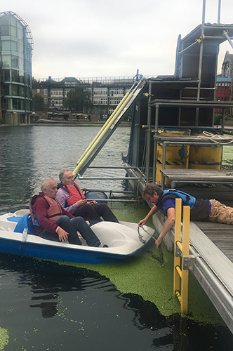Roger Saper and Andrew Shaw in a boat