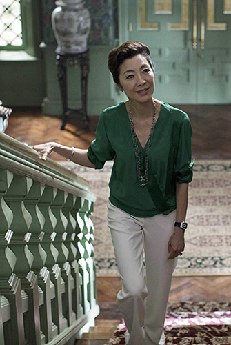Michelle Yeoh in Crazy Rich Asians - Photo by Sanja Bucko - © 2017 Warner Bros. Entertainment Inc. and RatPac-Dune Entertainment LLC - Credit IMDB