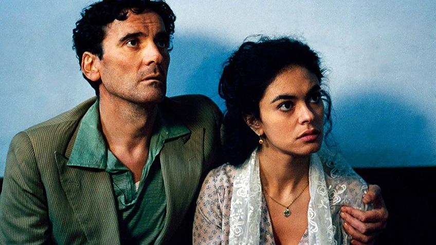 Maria Grazia Cucinotta and Massimo Troisi in Il Postino: The Postman - Credit IMDB