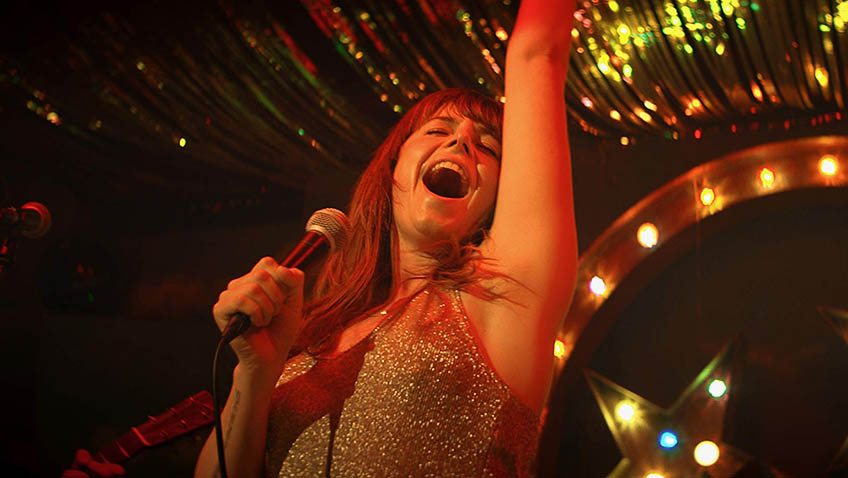 A star is born. There is no lip syncing on Jessie Buckley's road to the Grand Ole Opry