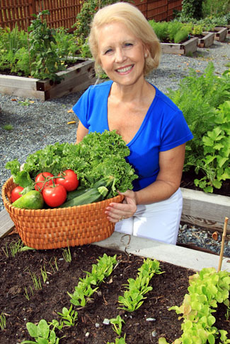 Woman with veg - Credit Garden Organic